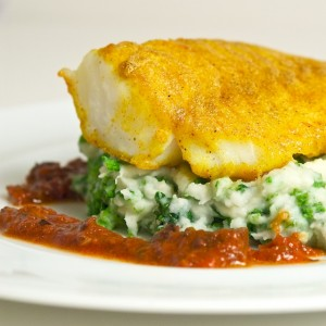 Curried Cod with Kale-Cannon and Tomato Olive Sauce